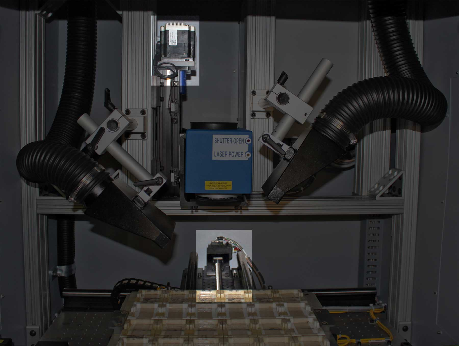 Intelligent rotary and linear MDrive products (circled in red) are mounted directly into the laser marking machine with stored programs controlling the system's motion.